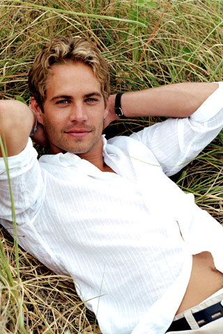 Actor Paul Walker Lying in Grass